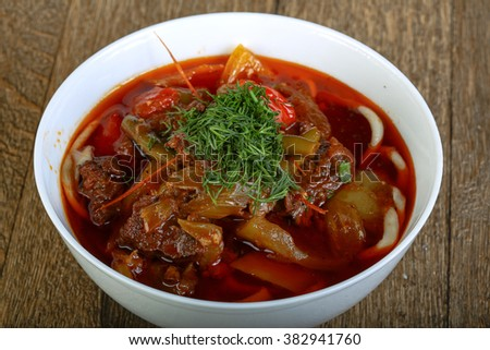 Uzbek noodle soup with lamb and tomato