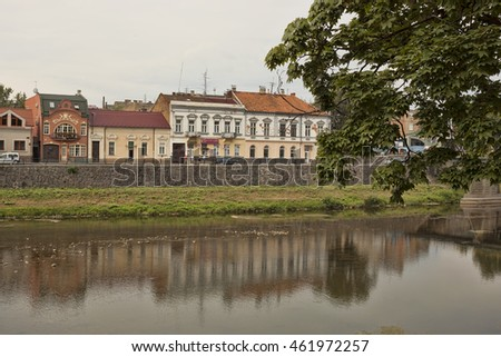 UZHGOROD, UKRAINE - AUGUST 3, 2015: River Uzh in Uzhhorod near the pedestrian bridge connecting the city with the oldest part of Uzhgorod. There are many tourists always