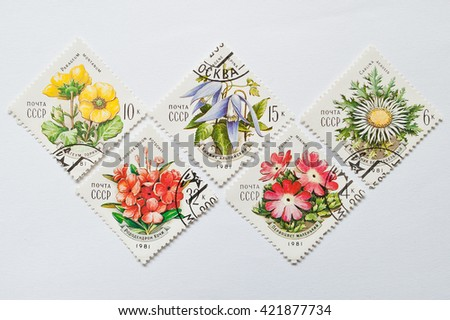 UZHGOROD, UKRAINE - CIRCA MAY, 2016: Collection of rhomb stamps printed in USSR, shows the series of different flowers, circa 1981 - stock photo