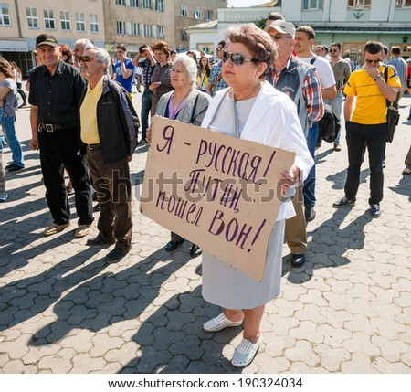 UZHGOROD, UKRAINE - MAY 1, 2014: Anti Putin demonstration in support of Ukraine's unity and termination of Russian aggression against Ukraine. Inscription on the poster: I am Russian. Putin Go away.