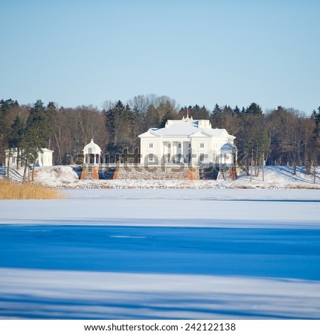 Uzutrakis manor estate in winter, Trakai, Vilnius, Lithuania, Europe. Uzutrakis manor ensemble was created in 1897-1902 by count Jozef Tyszkiewicz and his wife duchess Jadwiga Swietopulk-Czetwertynska - stock photo