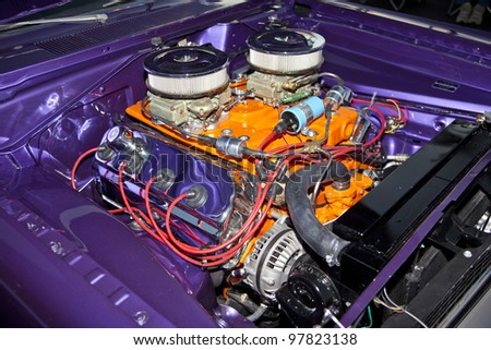 V-8 engine in a classic hot rod with dual carburetors and  painted in orange. - stock photo