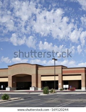 Vacant business offices and shopping mall with empty parking lot for rent or lease, Phoenix, AZ - stock photo