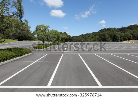 Vacant parking lot, parking lane outdoor in public park  - stock photo