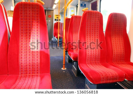 Vacant seats inside a train - stock photo