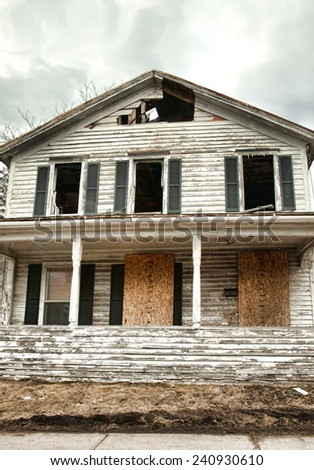 vacant urban house in ruins - stock photo