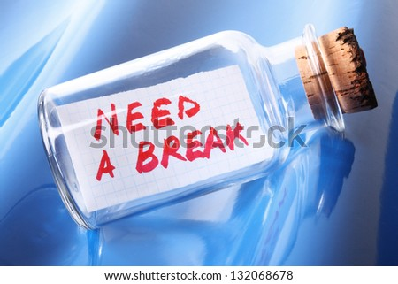 "Vacation and stress concept. Vintage bottle with text message ""need a break"" - stock photo"