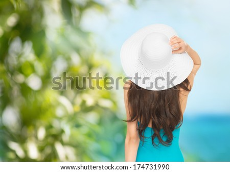vacation and summer holidays concept - model in swimsuit with hat - stock photo