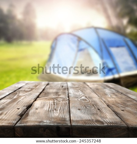 vacation background of tent and desk space of table top  - stock photo
