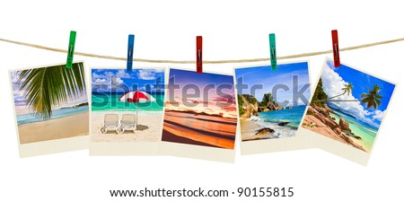 Vacation beach photography on clothespins isolated on white background - stock photo