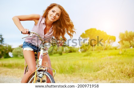 vacation in Italy. Girl on bike - stock photo