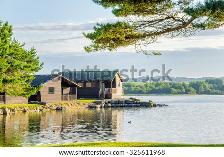 Vacation lodges by a lake - stock photo