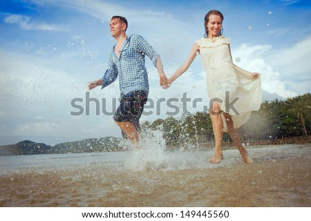 vacation, loving couple on the beach - stock photo
