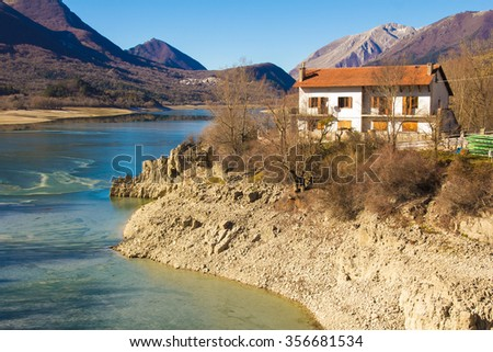 Vacation mountain cottage or house on the Barrea lake. - stock photo