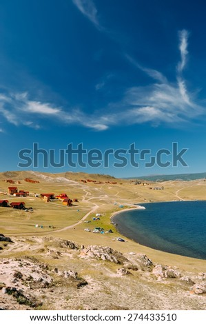vacation on the shores of Lake Baikal. Rest on the shore of the purest lake in the world. lake Baikal - stock photo