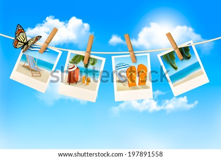 Vacation photos hanging on a rope.  - stock photo