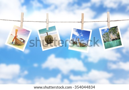 Vacation photos hanging on a rope, Thailand - stock photo