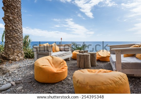 Vacation resort with comfortable seats near the sea at Madeira Island, Portugal - stock photo