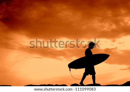 Vacation Silhouette Of A Surfer Carrying His Board Home At Sunset With Copy Space