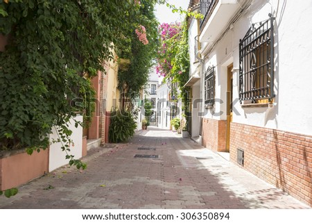 Vacation, streets of Marbella in Spain with flowers and plants on the facade - stock photo