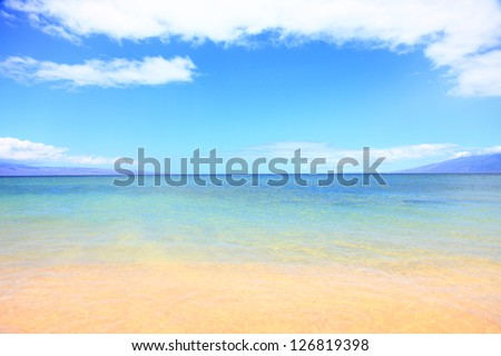 Vacation summer beach ocean background texture. Blue water, sky, sand and beach. Travel, vacation and summer holiday concept image from Maui, hawaii. - stock photo