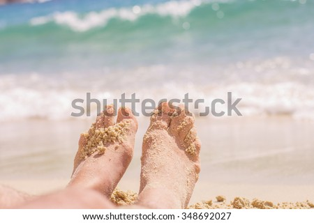 Vacation Summer Holiday,man feet on the sand beach
