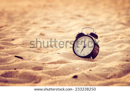 Vacation time concept  alarm clock on beach of lipe island, thailand. Retro filter - stock photo