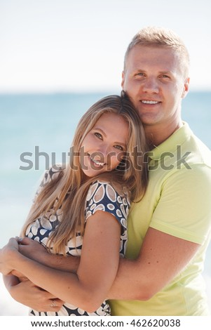 vacation, travel, sea, friendship and people concept - smiling couple by sea yachts. love, travel, tourism and people concept - smiling couple wearing sunglasses walking at harbor. rich and attractive