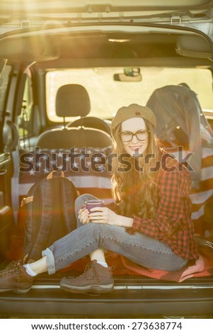 Vacation, travel - woman travel by car. baclkight, sunshine. grain added - stock photo