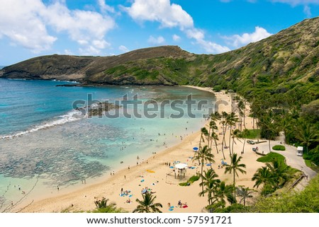 Vacationers relaxing on beautiful beach. - stock photo