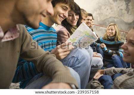 Vacationing Friends Checking a Map - stock photo
