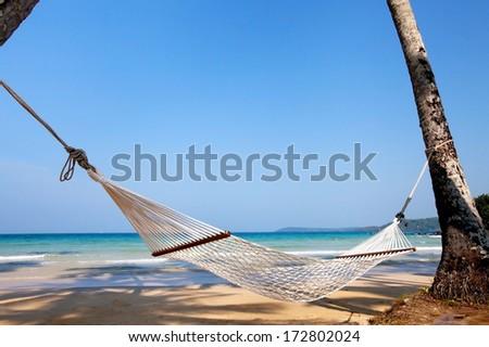 vacations, hammock on paradise beach - stock photo
