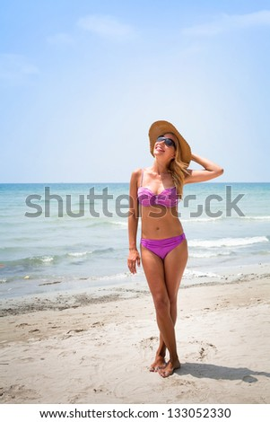 vacations on the beach, portrait of blond sexy woman - stock photo
