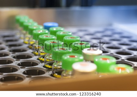Vaccine bottles in a holding tray - stock photo