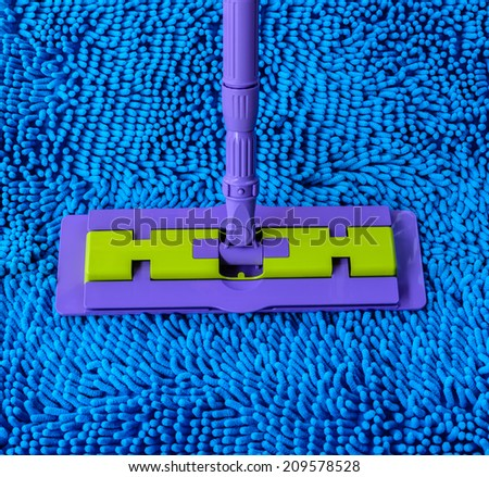 Vacuum cleaner for cleaning on blue carpet - stock photo
