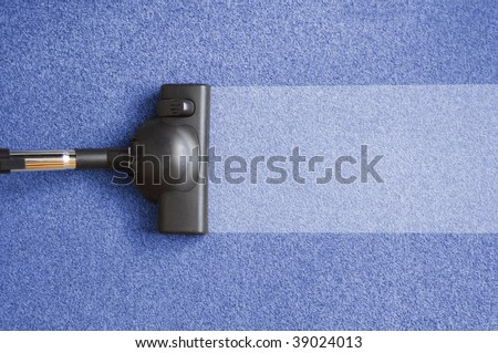 vacuum cleaner on the floor showing house cleaning concept - stock photo