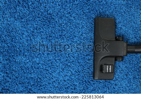 Vacuum cleaner to tidy up carpet - stock photo