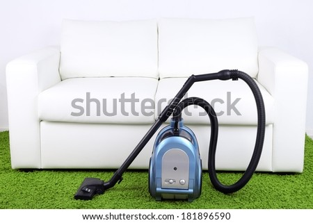 Vacuum cleaner to tidy up the living room - stock photo