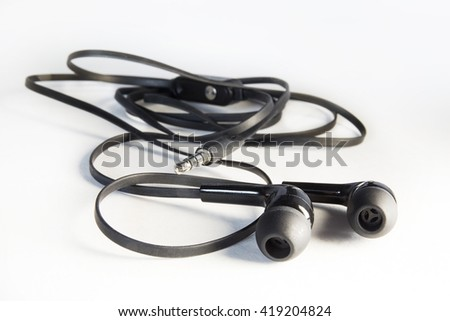 Vacuum headphones on a white background - stock photo