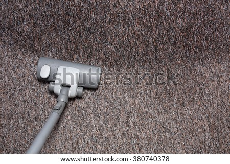 Vacuuming dirty carpet - stock photo