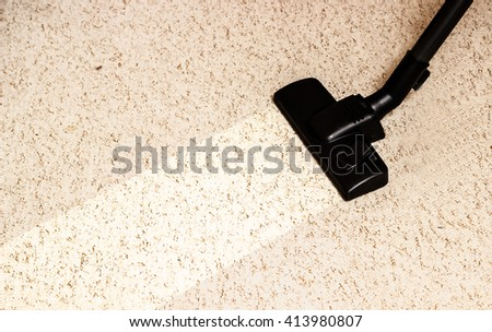 vacuuming the light carpet. border dirty and clean. cleaning service