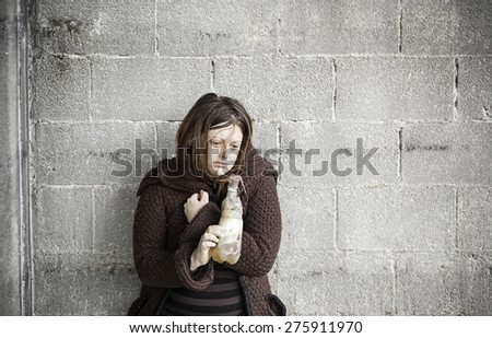 Vagabond drunk girl in abandoned house, Crisis - stock photo