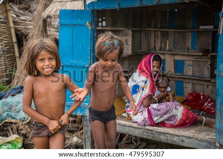VAISHALI, INDIA - JULY 18 2016: Poor Indian family in rural village on July 18, 2016 in Vaishali, India.