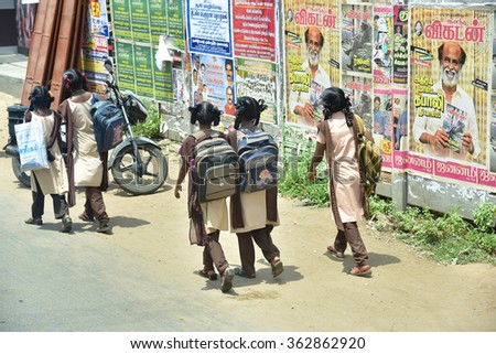 VAITHEESWARAN KOIL, TAMIL NADU, INDIA, SEPTEMBER 23, 2015: Girls in the village walking  to school on a sunny day carrying their books in their back-bag. - stock photo
