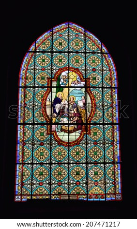 VAL DE SAMBRE, FRANCE-JULY 13, 2014: Stained glass window in the church in Paroisse St. Josef or Parish St. Josef in Val de Sambre