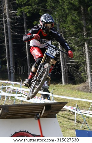 Val Di Sole, Italy - 22 August 2015: Madison Saracen Factory Team rider Simmonds Matthew, in action during the mens elite Downhill final World Cup at the Uci Mountain Bike