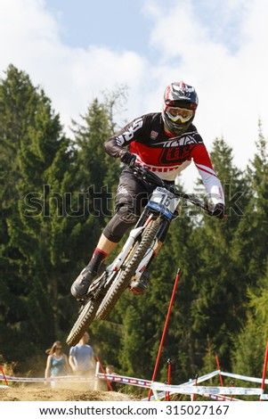Val Di Sole, Italy - 22 August 2015: Sram/Tld Racing Team,  Rider Shaw Luca in action during the mens elite Downhill final World Cup at the Uci Mountain Bike in Val di Sole, Trento, Italy