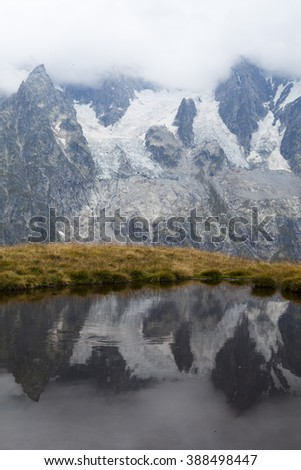 VAL FERRET, AO/ITALY - 04 SEPTEMBER 2014: glaciers, strange reflections in the water of a pond.