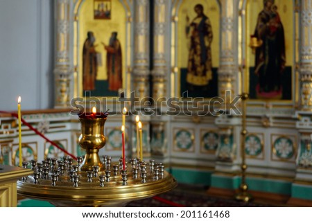 Valaam Island, Karelia, Russia - June 12, 2014: The lamp and candles in the Christian Church of the Resurrection monastery, consecrated in honor of the Resurrection of Christ.  - stock photo