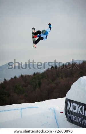 VALCA, SLOVAKIA - FEBRUARY 13: jump of  Matej Matys in final round of Nokia Freestyle Tour 2011 on February 13, 2011 in Valca, Slovakia - stock photo